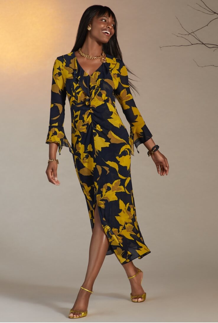 Model wearing the Midnight Dress in Flower Burst from the first New Arrivals Collection.