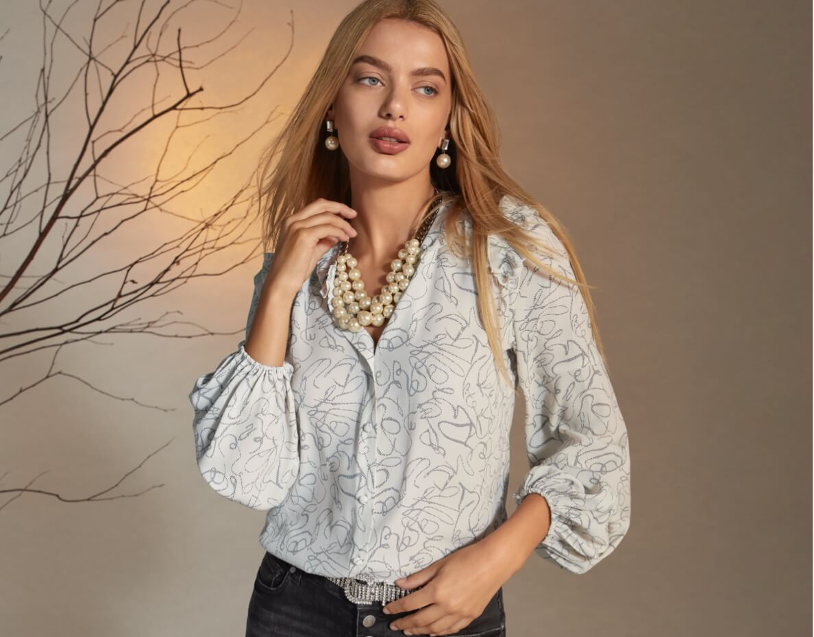 Model wearing the Ribbon Trim Blouse in Clip Art Print from the first New Arrivals Collection and Button Fly Straight in Carbon from the Mainline Collection.