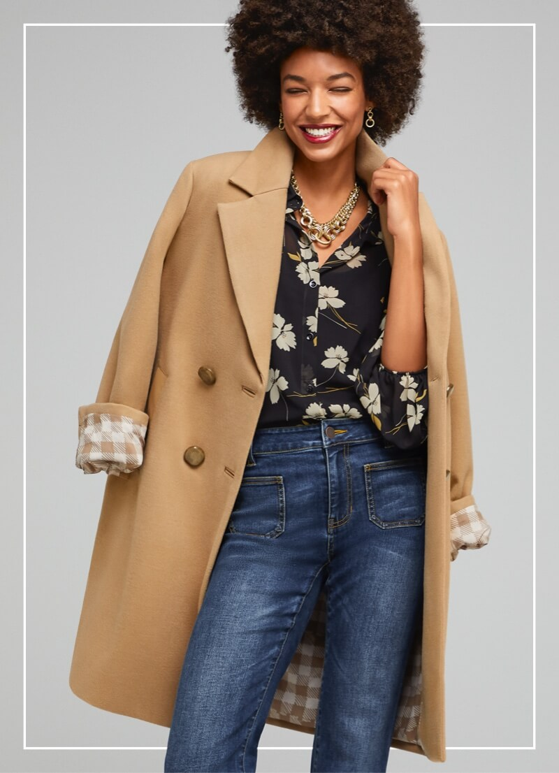 Model wearing the Heritage Coat in Camel, the Cosmo Blouse in Ivory Flower, and the Patch Pocket denim in Trader Wash.