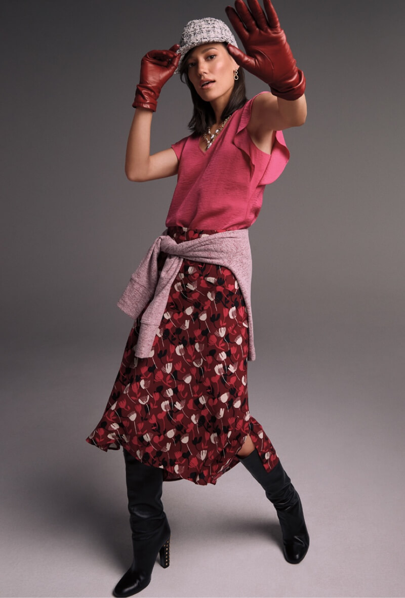 Model wearing Henley Pullover in Burgundy Mist, Rose Top in Bright Rose, Corsage Skirt in Wine Blossom.